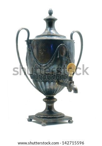 Antique sterling silver tea urn covered in thick layer of tarnish - stock photo