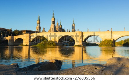 antique stone bridge in sunny morning. Zaragoza, Aragon