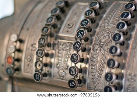 antique store silver cash register buttons close - stock photo