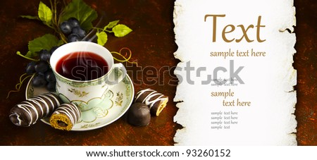 antique tea cup with a silver spoon - stock photo