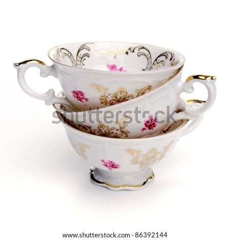 Antique tea cups on white background - stock photo
