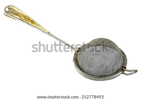 Antique tea strainer with considerable wear and use isolated over white background with clipping path