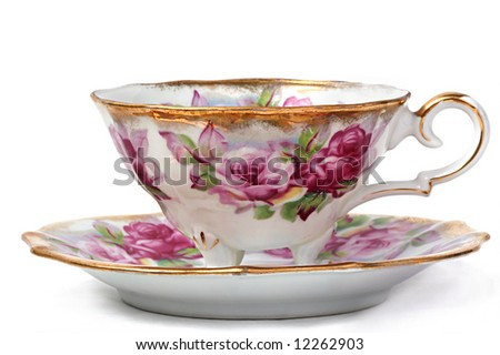 Antique Teacup and Saucer against a White Background