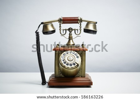 Antique telephone isolated on white background. Communication concept - stock photo