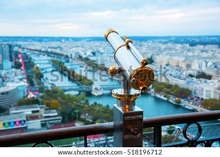 antique telescope with view over Paris, France, at dusk