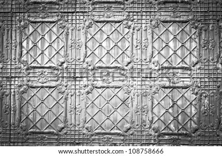 Antique tin wall in black and white, great for scrap booking or digital photography backdrop - stock photo