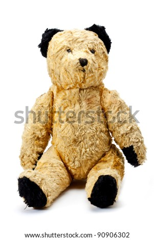 Antique toy bear in fantastic condition on a white background.  Antique bear. - stock photo
