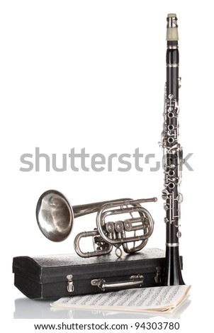 antique trumpet, clarinet and case isolated on white - stock photo