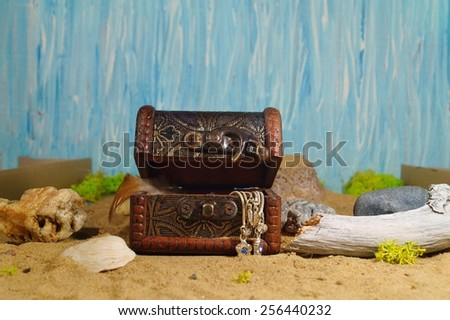 Antique trunk coated with iron - trunk with jewelery and souvenirs - stock photo