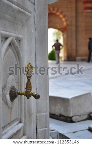Antique Turkish faucet (water tap) - stock photo