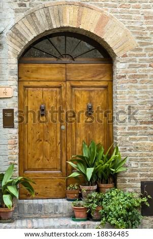 Antique Tuscany door - stock photo
