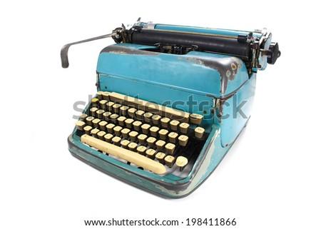 Antique typewriter against a crisp white backdrop. - stock photo