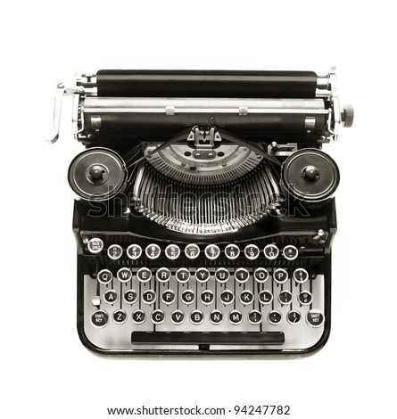 Antique typewriter against a crisp white backdrop. - stock photo