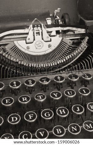 Antique Typewriter - An Antique Typewriter Showing Traditional QWERTY Keys VIII - stock photo