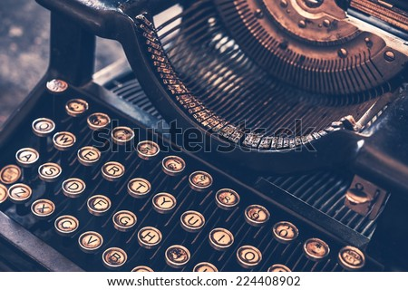 Antique Typewriter. Vintage Typewriter Machine Closeup Photo. - stock photo