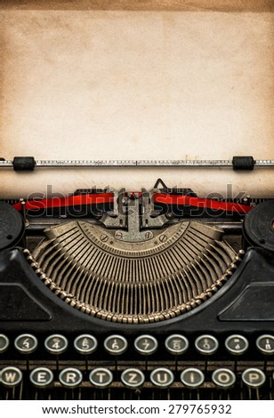 Antique typewriter with aged textured paper sheet with space for your text - stock photo