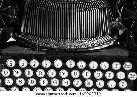 Antique Typewriter X - An Antique Typewriter Showing Traditional Typebars and QWERTY Keys - stock photo