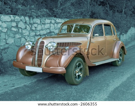Antique vintage car (colored) on monochromatic background, jpeg file contain clipping path - stock photo