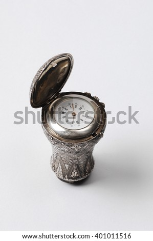 antique walking stick clock isolated - stock photo