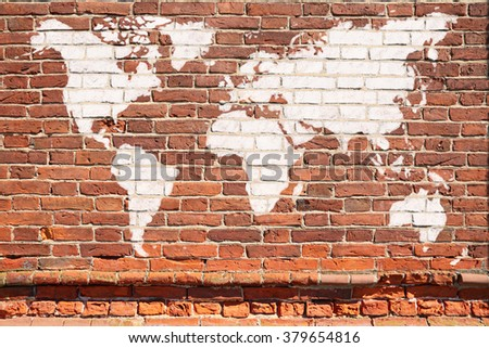Antique wall from brick with World map graffiti - stock photo