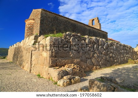 Antique walls of Hades sanctuary and a Byzantine church built on top of it, Greece - stock photo