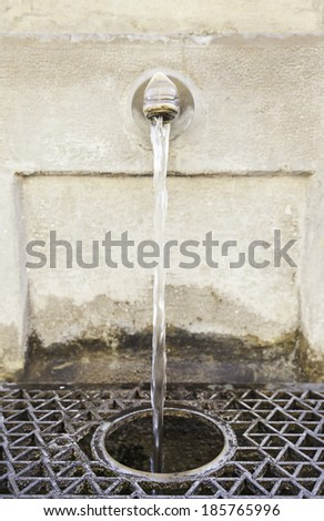 Antique water fountain, detail of a source for drinking water, drinking water - stock photo