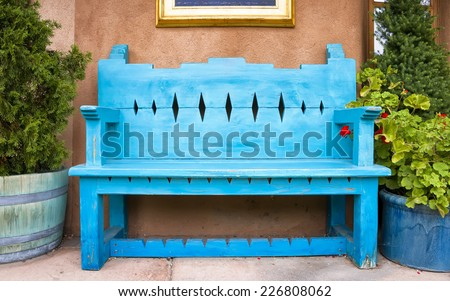Antique Wooden Bench Outside of a Gallery in Santa Fe, NM - stock photo