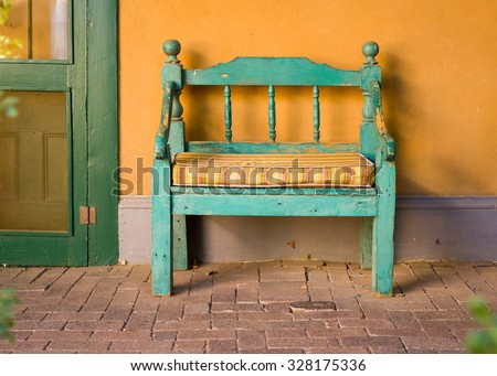 Antique Wooden Bench Outside of a Garden in Santa Fe, NM - stock photo
