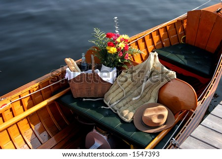 Antique wooden boat with period clothing - stock photo