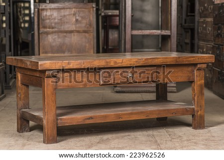 Antique wooden desk in cabinet background - stock photo