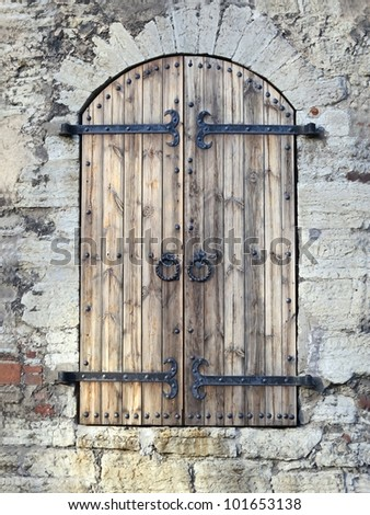 Antique Wooden Door With Iron Hinges And Old Metal Handles