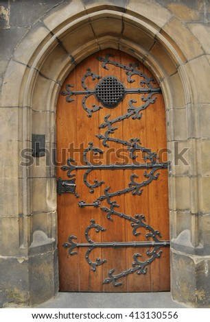 antique wooden doors in Prague - stock photo