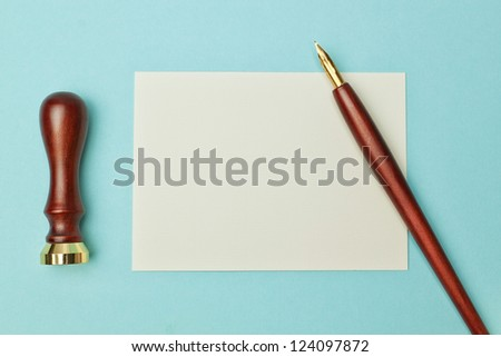 Antique wooden pen to ink and paper for writing. - stock photo