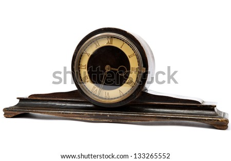 Antique wooden table clock on a white background.