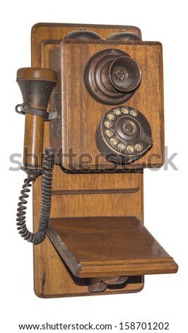 Antique wooden telephone with rotary dial, isolated with clipping path - stock photo