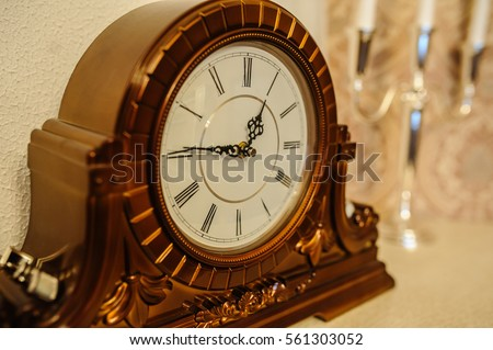 antique wooden vintage wall clock isolated on backgroun