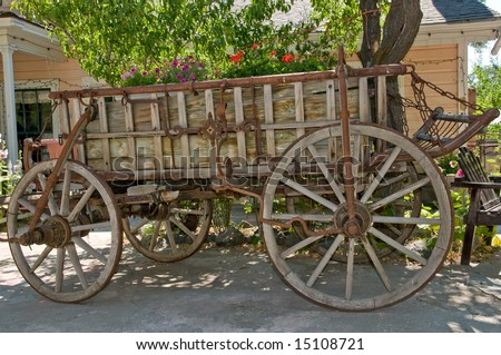antique wooden wagon placed as decoration in front yard - stock photo