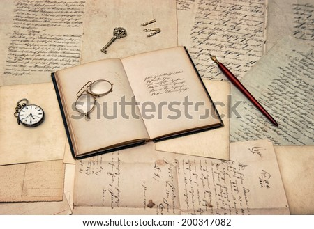 antique writing accessories, open diary book, old letters and postcards. nostalgic sentimental background - stock photo