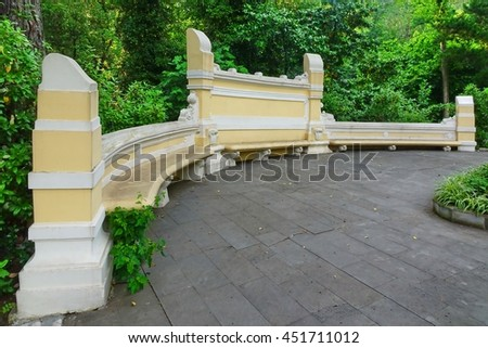 Antique Yellow Stone Bench In The Public Botanical Park And Tropical Summer Garden In The Background, Russia, Sochi - stock photo
