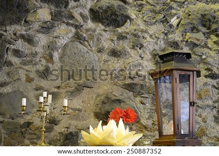antiques on stone wall background