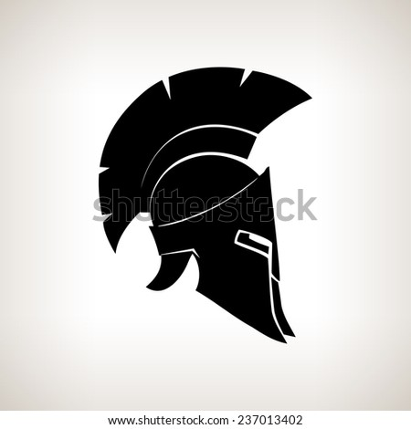 Antiques Roman or Greek helmet for head protection soldiers with a crest of feathers or horsehair with slits for the eyes and mouth - stock photo