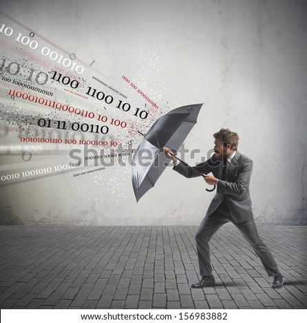 Antivirus and firewall concept with businessman and umbrella - stock photo
