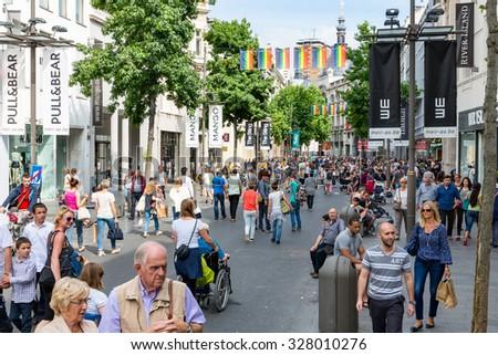 ANTWERP, BELGIUM - AUG 11: People in the main shopping street of Antwerp downtown in the city on August 11, 2015 in Antwerp, Belgium - stock photo