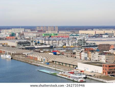 ANTWERP, BELGIUM - MARCH 7, 2015: View on warehouses by the River Scheldt in the port of Antwerp, Belgium. - stock photo