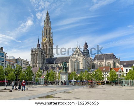 ANTWERP, BELGIUM - MAY 24: Cathedral of Our Lady and statue of Peter Paul Rubens on May 24, 2013 in Antwerp, Belgium. The cathedral is the highest church in the Benelux with 123 m (404 ft) of height. - stock photo