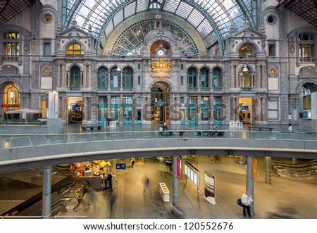 ANTWERP, BELGIUM - NOV 23: Symmetrical composition of the main hall of the famous Antwerp Railway train station, also known as the cathedral amongst stations on November 23, 2012 in Antwerp, Belgium - stock photo