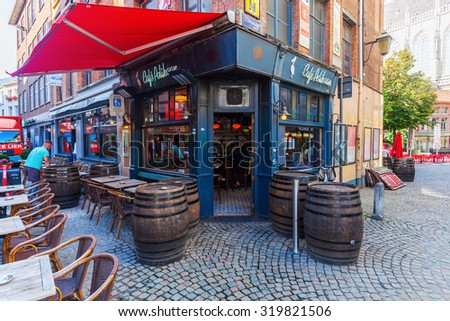 ANTWERP, BELGIUM - SEPTEMBER 03, 2015: cafe in old town of Antwerp with unidentified people. Antwerp is the capital of Antwerp province and with a population of 510,610 most populous city in Belgium - stock photo