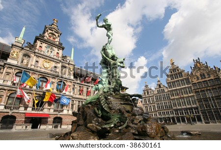 Antwerp market place with City Hall, houses and famous statue and fountain by Brabo - stock photo