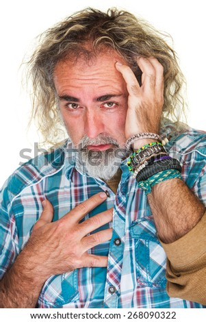 Anxious bearded male holding chest and head - stock photo