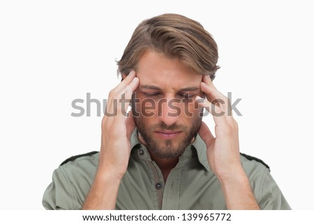 Anxious man with eyes closed on white background - stock photo